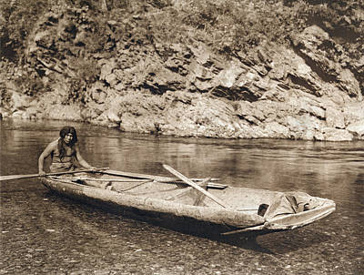 Dugouts Photograph - A Yurok In His Dugout Canoe by Underwood Archives