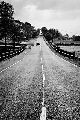 Carriageway Photograph - A69 Road On The Border Of Cumbria And Northumberland Uk by Joe Fox