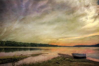 Laura James Photograph - Abandoned Boat At Shoreline by Laura James