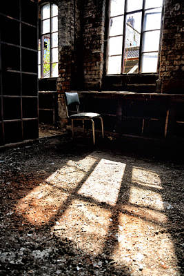 Atmospheric Photograph - Abandoned Chair Sits In Sunlight By An Abandoned Window by Russ Dixon