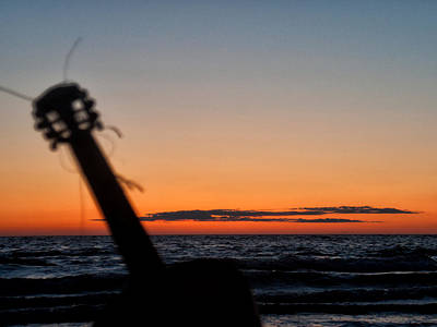 Acoustic Guitar On The Beach Art Print by Mike Santis