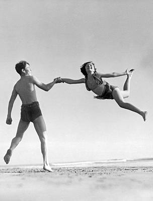 Beach Scenes Photograph - Acrobatic Beach Exhibition by Underwood Archives
