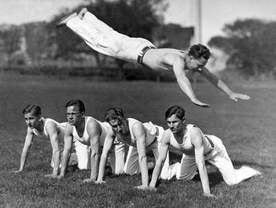 Exercise Photograph - Acrobatic Swandive by Underwood Archives
