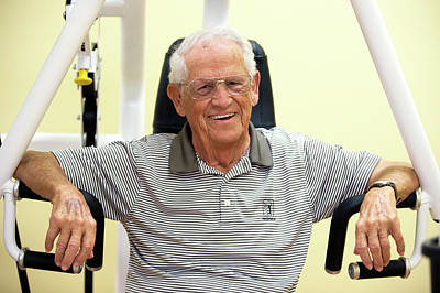 Aging Photograph - Active Elderly Man Smiling In Gym by Alex Rotas