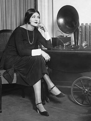 Electronics Photograph - Actress Listens To Father Play by Underwood Archives