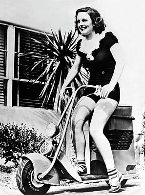 912 Photograph - Actress Riding A Scooter by Underwood Archives