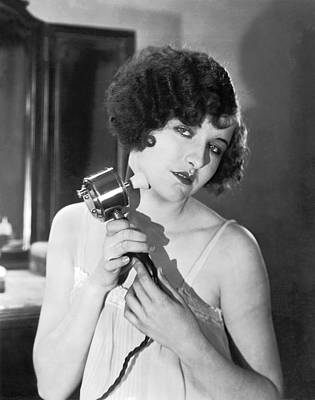 Massaging Photograph - Actress Using Massage Device by Underwood Archives