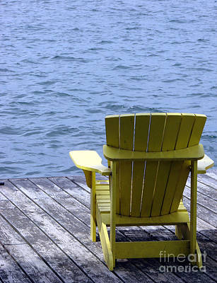 Adirondack Chair On Dock Art Print by Olivier Le Queinec