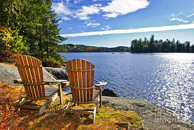 Landscapes Royalty-Free and Rights-Managed Images - Adirondack chairs at lake shore 1 by Elena Elisseeva