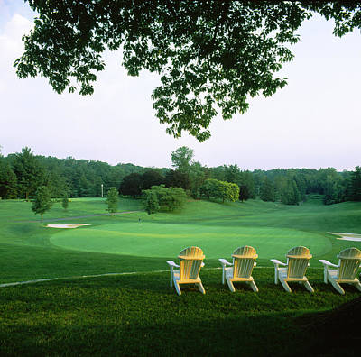 Non-urban Scene Photograph - Adirondack Chairs In A Golf Course by Panoramic Images