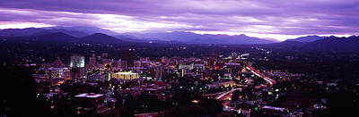 Asheville Photograph - Aerial View Of A City Lit Up At Dusk by Panoramic Images
