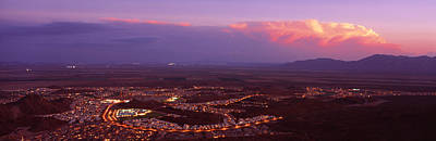 Aerial View Of A City Lit Up At Sunset Print by Panoramic Images