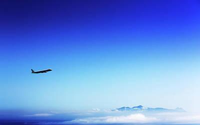 Aeroplane Flying In A Clear Blue Sky Art Print by Wladimir Bulgar