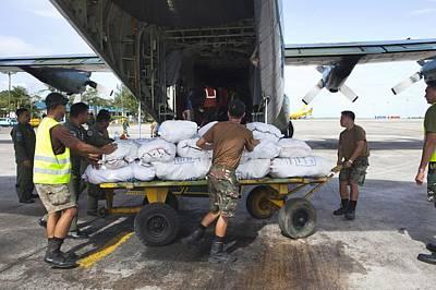 C-130 Wall Art - Photograph - Aid For Super Typhoon Haiyan Survivors by Jim Edds