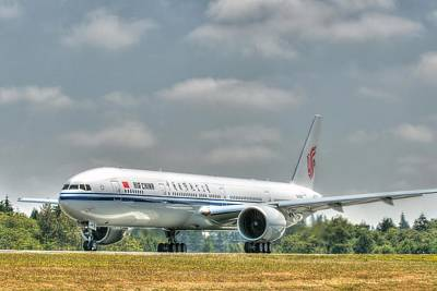 Art Print featuring the photograph Air China 777 by Jeff Cook