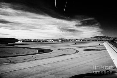 aircraft on runway and taxiway waiting to take off at McCarran International airport Las Vegas Art Print by Joe Fox