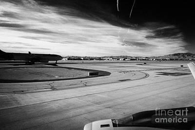 aircraft on runway and taxiway waiting to take off at McCarran International airport Las Vegas Nevad Art Print by Joe Fox