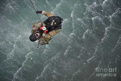 Modern Feathers Art - Airmen Are Hoisted Out Of The Water by Stocktrek Images