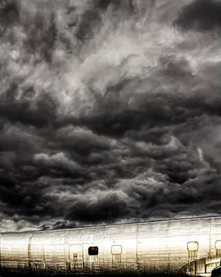 Turbulent Skies Photograph - Airplane by Bob Orsillo