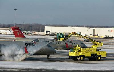Airliners Photograph - Airplane De-icing by Jim West