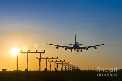 Travel Photograph - Airplane Landing At Sunset, Canada by David Nunuk