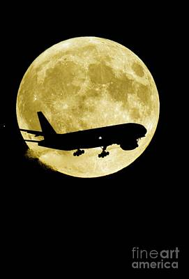 Passenger Plane Photograph - Airplane Silhouetted Against A Full Moon by David Nunuk