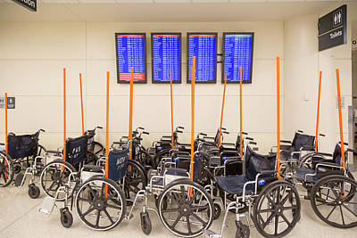 Concourse Photograph - Airport Wheelchairs by Jim West