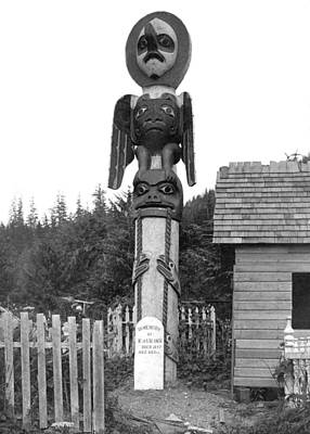 Totem Pole Photograph - Alaskan Totem Pole by Underwood Archives