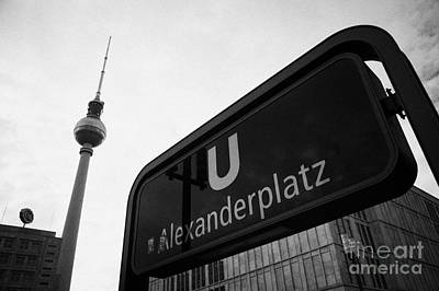 U-bahn Photograph - Alexanderplatz U-bahn Station Entrance Sign And Tv Tower Berliner Fernsehturm Berlin Germany by Joe Fox