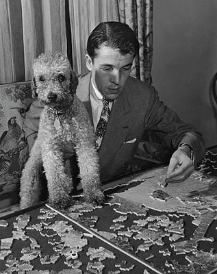 Candid Photograph - Alfred Gwynne Vanderbilt Completing A Puzzle by Swope John