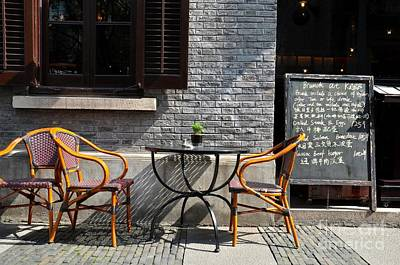 Photograph - Alfresco Restaurant Table Cane Chairs And Chalkboard Menu Shanghai China by Imran Ahmed