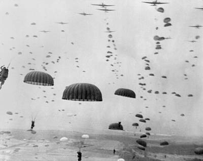 Bsloc Photograph - Allied Aircraft Drop Paratroopers by Everett