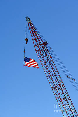 Photograph - American Flag On Construction Crane by Olivier Le Queinec