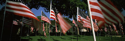 Fluttering Photograph - American Flags In Front Of A Home by Panoramic Images