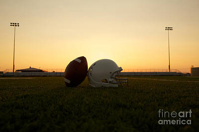 Photograph - American Football And Helmet On The Field At Sunset by David Lee