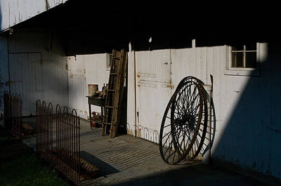 Photograph - Amish Buggy Wheel by Greg Graham