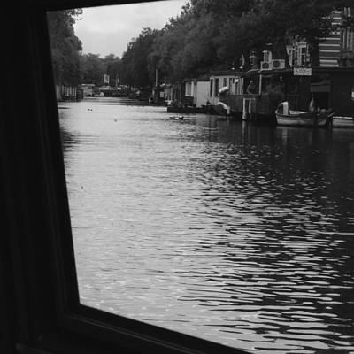Photograph - Glimpse Of Amsterdam Canal by Cheryl Miller