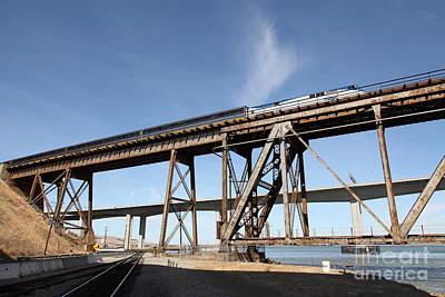 Amtrak Train Riding Atop The Benicia-martinez Train Bridge In California - 5d18775 Art Print by Wingsdomain Art and Photography