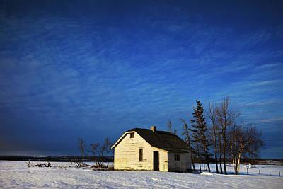 An Abandoned Homestead On A Snow Print by Steve Nagy