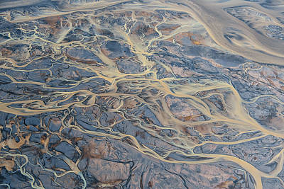 Photograph - An Aerial Of Streams Of Glacier Runoff by Keith Ladzinski