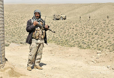 An Afghan Border Policeman Secures Art Print by Stocktrek Images