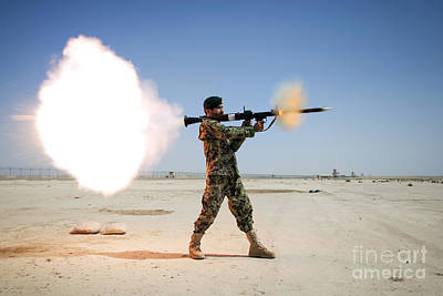 An Afghan National Army Soldier Fires Art Print by Stocktrek Images