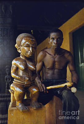 Bedouin Photograph - An African Wood Carver And His Statue In Mali 1959 by The Harrington Collection