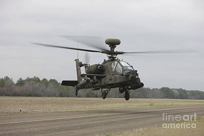 On The Runway Photograph - An Ah-64 Apache Helicopter In Midair by Terry Moore