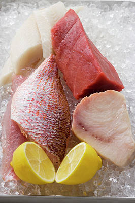 Fish Fillet Photograph - An Assortment Of Fish Fillets With Lemon On Ice by Foodcollection