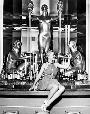 Cocktails Photograph - Sexy Woman On The Bar by Underwood Archives