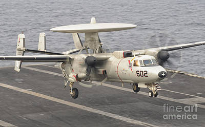 On The Runway Photograph - An E-2c Hawkeye Landing On The Flight by Giovanni Colla