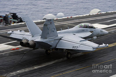Catch Of The Day - An Ea-18g Growler Lands On The Flight by Stocktrek Images