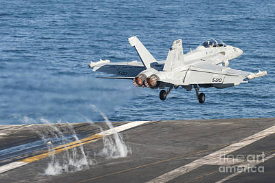 Transportation Royalty-Free and Rights-Managed Images - An Ea-18g Growler Launches by Stocktrek Images