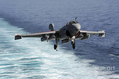Prowler Photograph - An Ea-6b Prowler Lands Aboard by Stocktrek Images